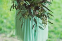 16 a seeded eucalyptus and a large succulent bridesmaid' bouquet is an unusual option to go for
