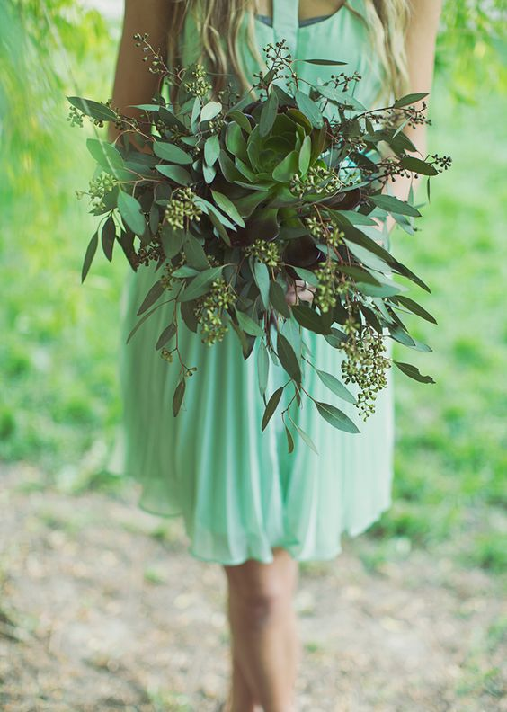 a seeded eucalyptus and a large succulent bridesmaid' bouquet is an unusual option to go for
