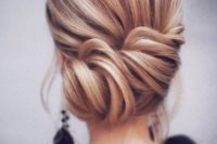 16 a simple twisted side updo with a volume on top and some locks down is a timeless idea