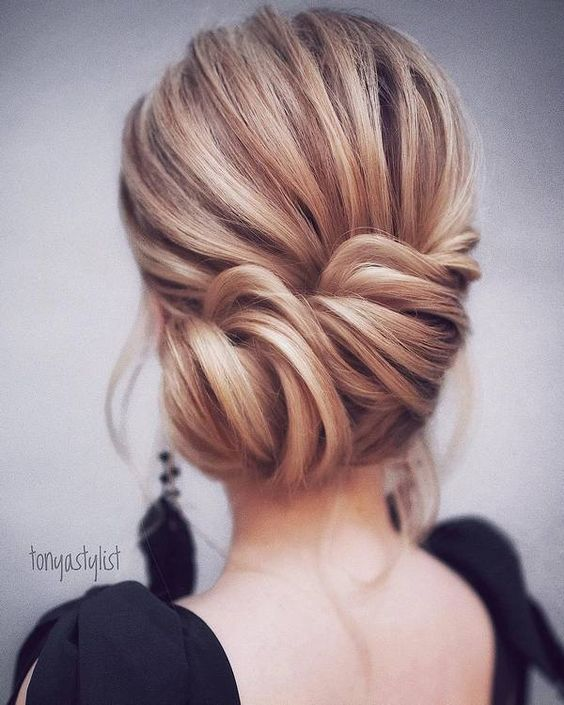 a simple twisted side updo with a volume on top and some locks down is a timeless idea