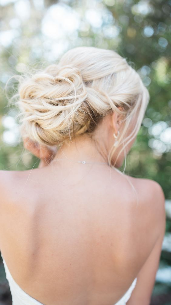 a twisted low bun with some locks down for a chic and elegant look