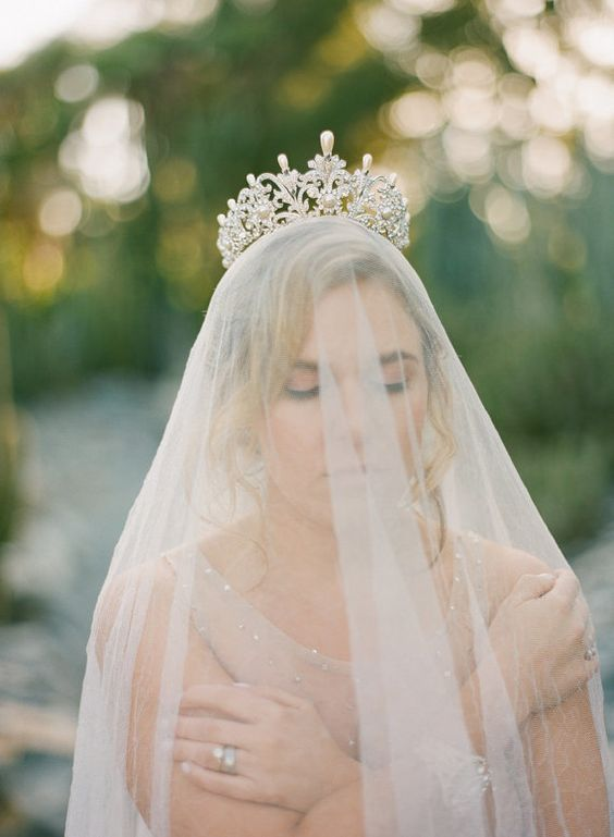 a glam bridal tiara with pearls and Swarovski crystals and a long veil for a royal look