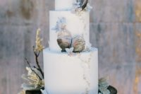 17 a gorgeous beach wedding cake in white decorated with incredible sugar oyster shells, edible perals and pale blooms