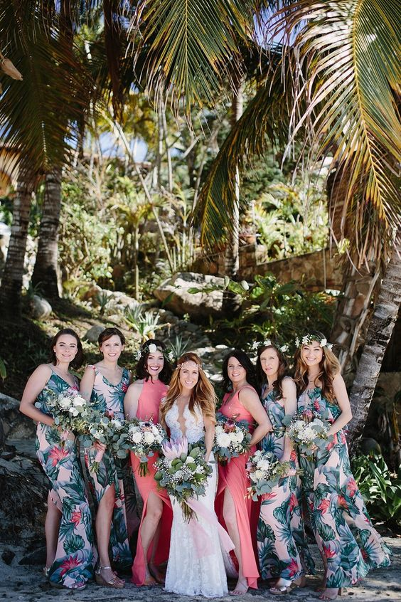 tropical beach bridesmaids' dresses with a bold leaf and flower print and side slits