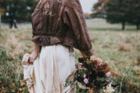18 a boho bride wearing a blush wedding dress, brown booties and a brown leather jacket with calligraphy