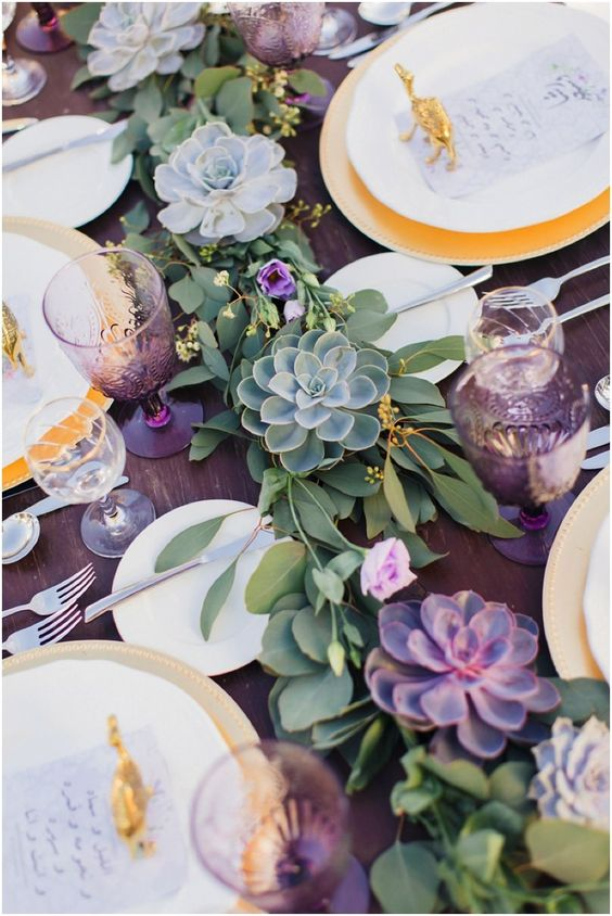 a fresh greenery table runner with pale succulents and pink blooms for a gorgeous tablescape