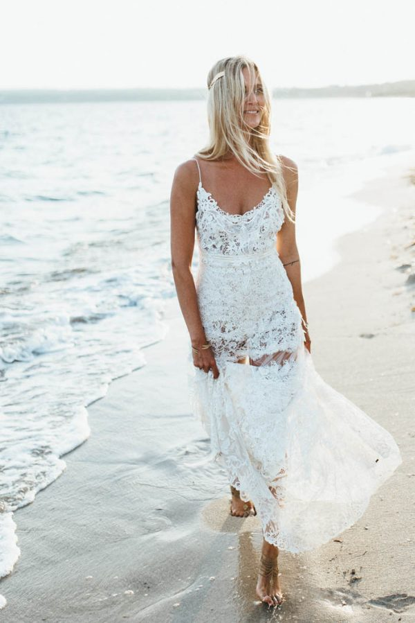 a lace spaghetti strap wedding dress with a scoop neckline and an illusion skirt