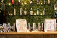 18 a living wall as a bar backdrop and glass shelves not to spoil the look