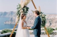 18 a wooden ceremony arch with creamy blooms, greenery and pampas grass for a light boho feel
