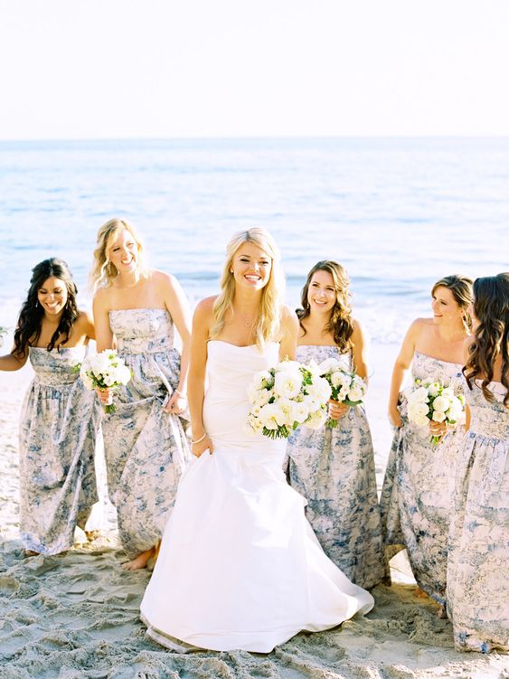 strapless maxi gowns with a blue floral print fit a beach or coastal wedding perfectly