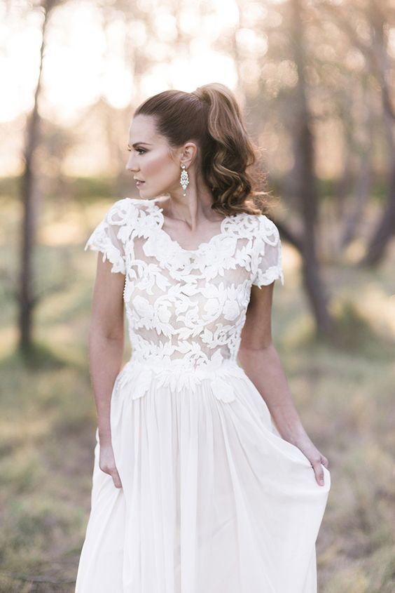a high ponytail with waves is classics that will fit many bridal styles and looks