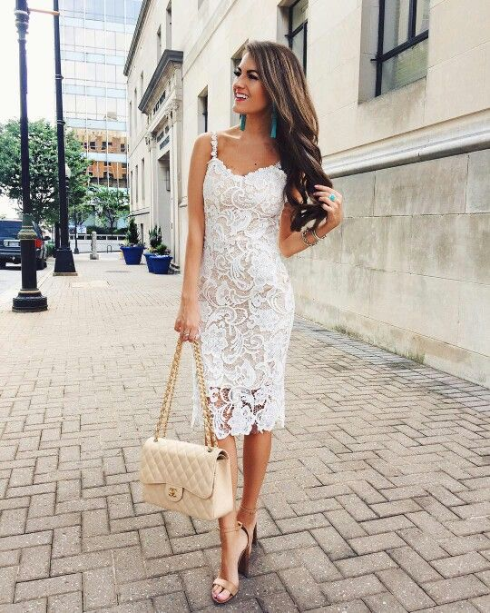 a lace sheath midi dress with spaghetti straps, nude shoes and statement earrings and a ring