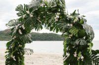 semi circle wedding altar for a tropical wedding