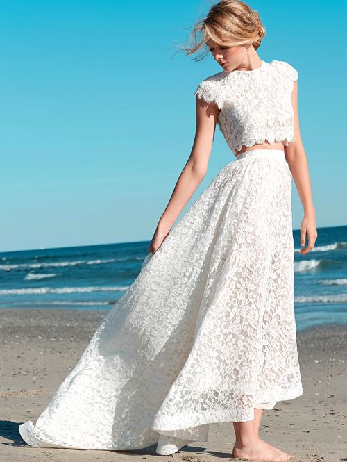 a stunning lace wedding separate with a crop top and a high low midi skirt with a train