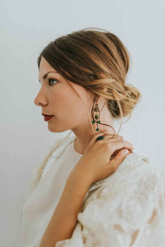 bold chandelier emerald earrings and a matching ring for a vintage boho bride
