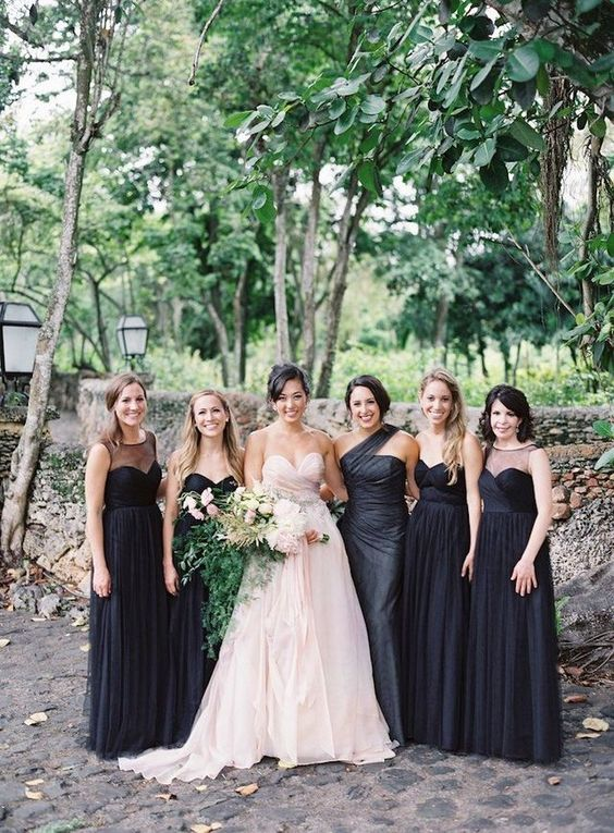 super elegant mismatching black bridesmaids' dresses to make the bride stand out even more