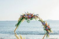20 a creative hexagon wedding arch decorated with colorful blooms, greenery and pampas grass