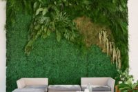 20 a living wall with greenery, fern and leaves as a wedding lounge backdrop that brings a fresh feel in