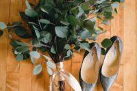 20 a simple eucalyptus wedding bouquet with a blush ribbon wrap for a minimalist bride