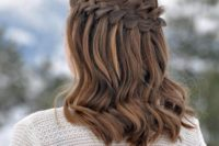 20 a waterfall braid hairstyle with some waves down for a boho chic feel
