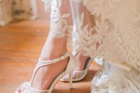 20 chic white wedding heels with a sheer and lace applique and embellished part plus a T-strap for a refined feel