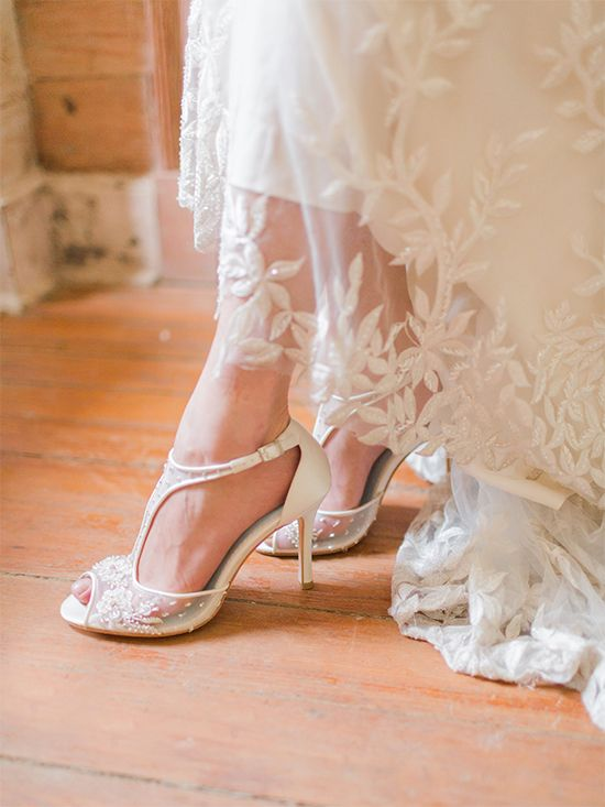 chic white wedding heels with a sheer and lace applique and embellished part plus a T strap for a refined feel
