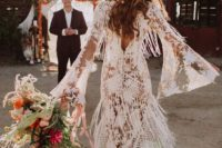 21 a boho lace wedding dress with bell sleeves and fringe for a free-spirited feel