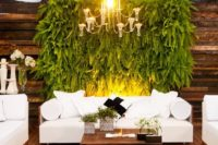 21 a lush fern wall over the wedding lounge is a gorgeous, trendy and very refreshing idea