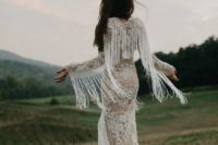 22 a boho lace sheath wedding dress with long fringed sleeves for a wild look
