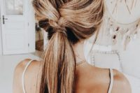 22 a braid going into a low ponytail with a bit of mess is great for a boho bride-to-be