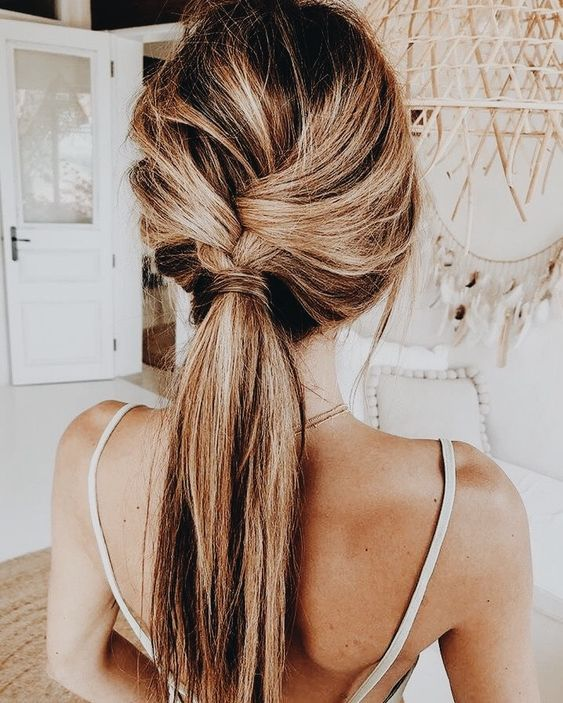 a braid going into a low ponytail with a bit of mess is great for a boho bride-to-be