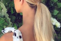 22 a comfy low ponytail with dimension on top and some texture on the ponytail is a great last-minute idea