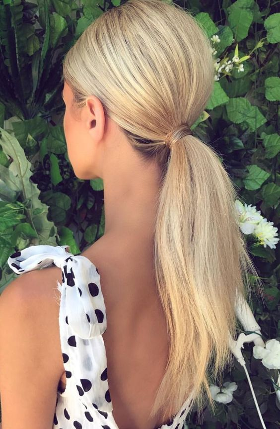 a comfy low ponytail with dimension on top and some texture on the ponytail is a great last-minute idea