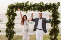 trendy wedding arch for a tropical wedding