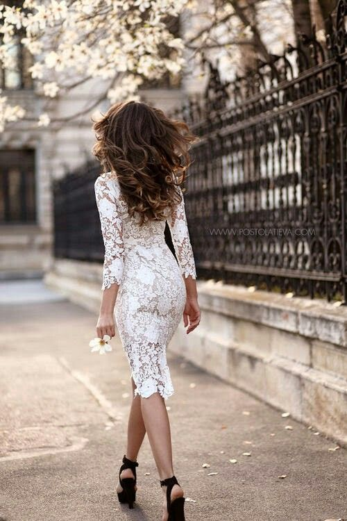 a white fitting lace midi dress with long sleeves and black shoes for a feminine feel