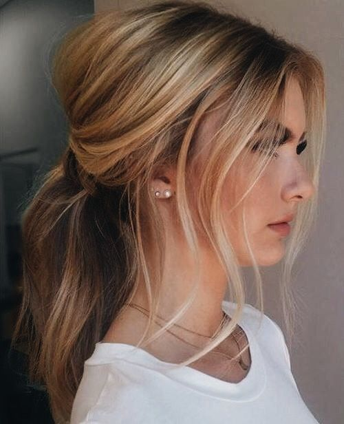 a stylish and messy ponytail with some volume, waves and locks down is a chic casual option
