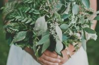23 a very lush and large wedding bouquet of evergreens and eucalyptus for a casual bride
