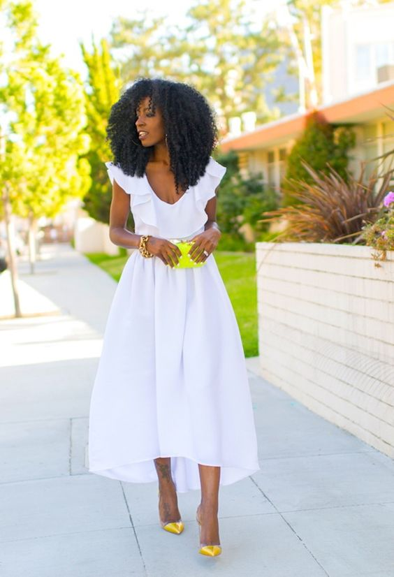 a white high low midi dress with a ruffled neckline, neon yellow shoes and a clutch for a colorful touch