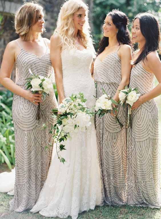 glam bridesmaids' dresses with spaghetti straps and heavy embellishements look very cool