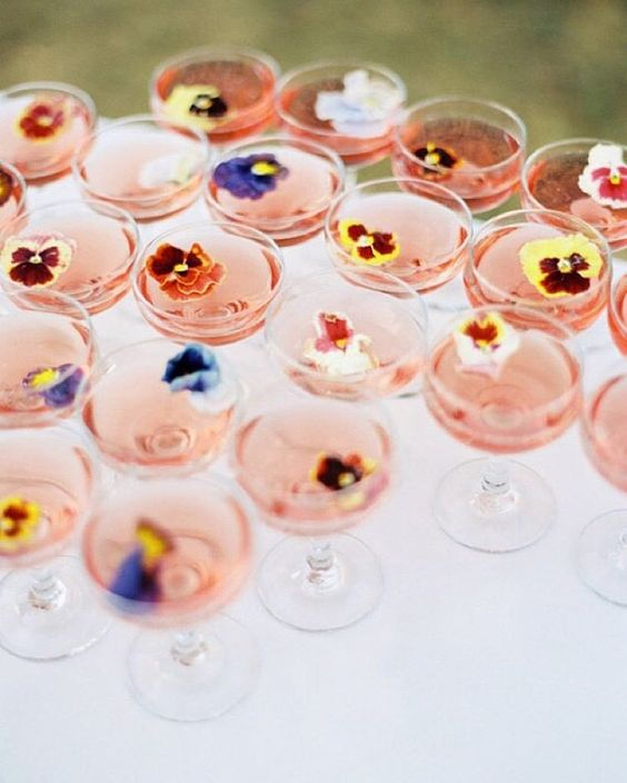 serve drinks with edible flowers or flower petals to give them a cute glam look and a garden feel