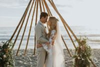 23 trendy teepee-like wedding arbor with greenery and blooms on each corner for a bold look