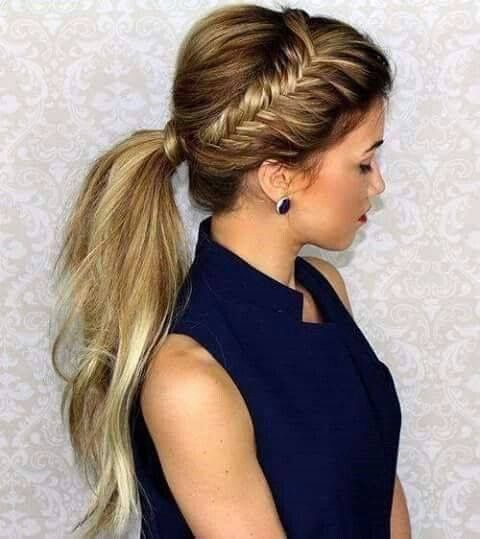a low ponytail with a side brain and a small bump looks modern and bold