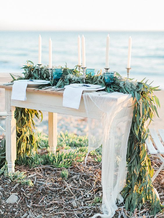 a seagrass table runner is ideal for a coastal or beach wedding and is a creative and textural element