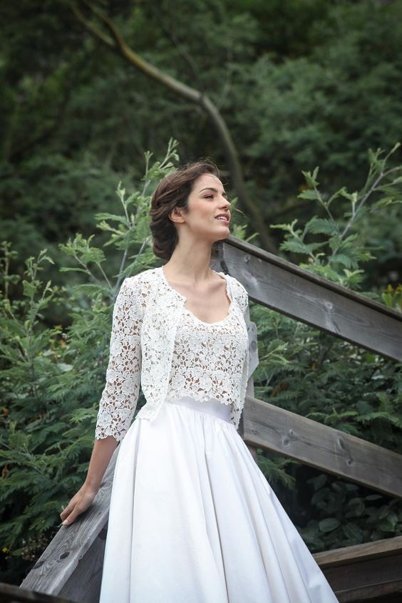 a white sleek full skirt, a lace crop top and cropped long sleeve jacket for an ethereal look