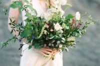24 a wildflower wedding bouquet with textural greenery, white blooms and various herbs