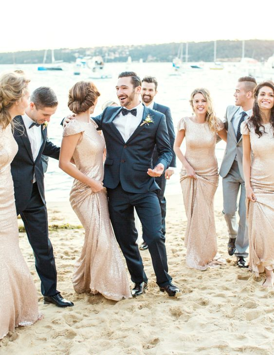 glam bridesmaids wearing gold sequin maxi dresses with cap sleeves look amazing