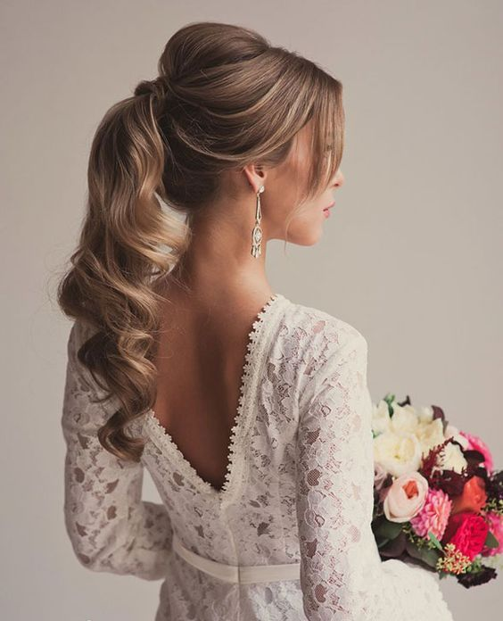 a romantic ponytail with volume on top, some locks down and curls on the ends