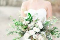 25 an organic wedding bouquet with various greenery and white flowers for a coastal wedding