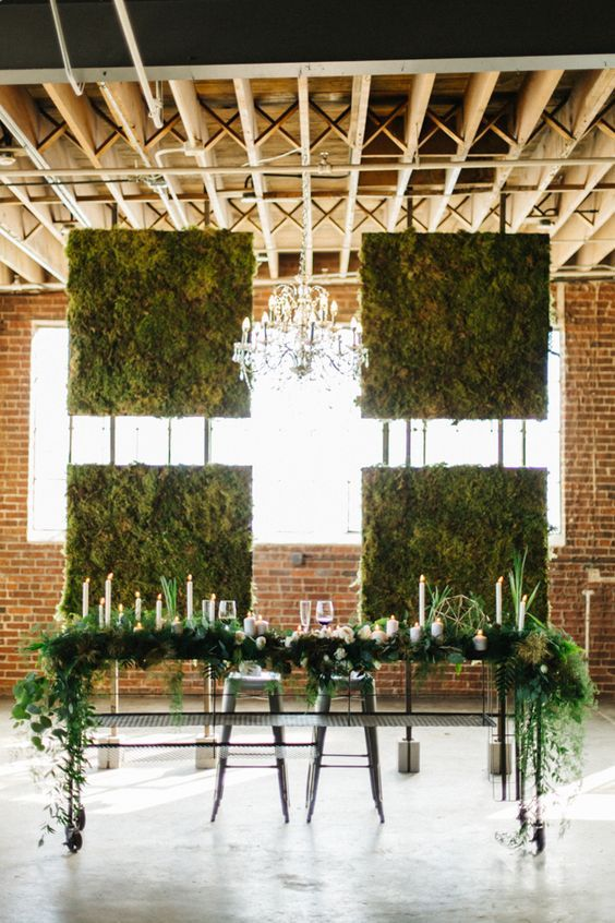 four moss walls attached so that the light went through and a greenery table runner