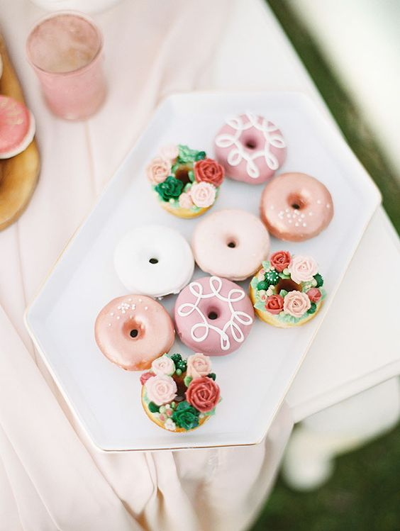 glazed donuts and donuts decorated with icing flowers and greenery look super cute and fun